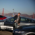 Daniel Myggen, Tesla sales operations, gets out of a Tesla Model S after parking it during a stop in San Francisco on a journey from San Diego to Vancouver powered only by Tesla Superchargers on Thursday, October 31, 2013 in San Francisco, Calif. (Photo By Lea Suzuki/The San Francisco Chronicle via Getty Images)