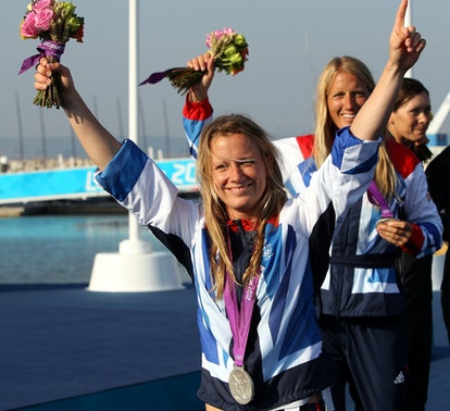 Great Britain's Olympic silver medalists Hannah Mills and Saskia Clark leave after the medal ceremon...