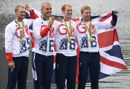Britain's Mohamed Sbihi, Alex Gregory, Constantine Louloudis and George Nash pose with their gold me...