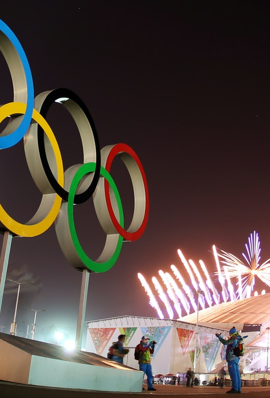 The Olympic Rings are seen as fireworks explode during the Closing Ceremony in Fisht Olympic Stadium...
