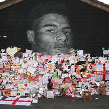Messages are seen at the newly repaired mural of England footballer Marcus Rashford by the artist known as AKSE_P19, which is displayed on the wall of a cafe on Copson Street, Withington on July 14, 2021 in Manchester, England. Rashford and other Black players on England's national football team have been the target of racist abuse, largely on social media, after the team's loss to Italy in the UEFA European Football Championship last night. England manager Gareth Southgate, Prime Minister Boris Johnson, and the Football Association have issued statements condemning the abuse