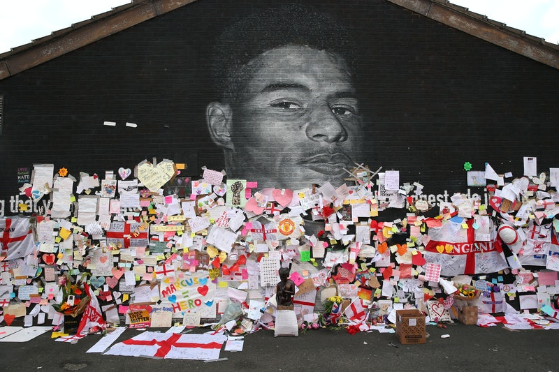 Messages are seen at the newly repaired mural of England footballer Marcus Rashford by the artist kn...