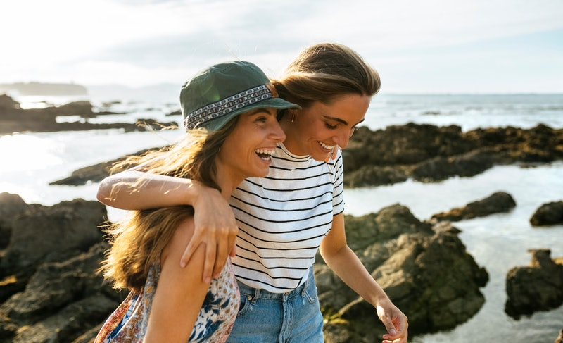 A woman supports her friend after a bad breakup. Experts & people who've been there share how to hel...