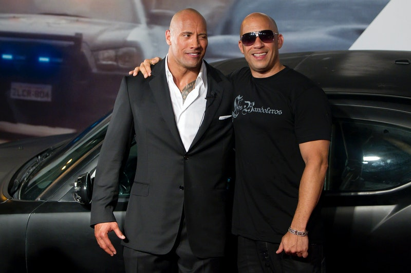 Dwayne Johnson (The Rock) and Vin Diesel (R) pose for photographers during the premiere of the movie...
