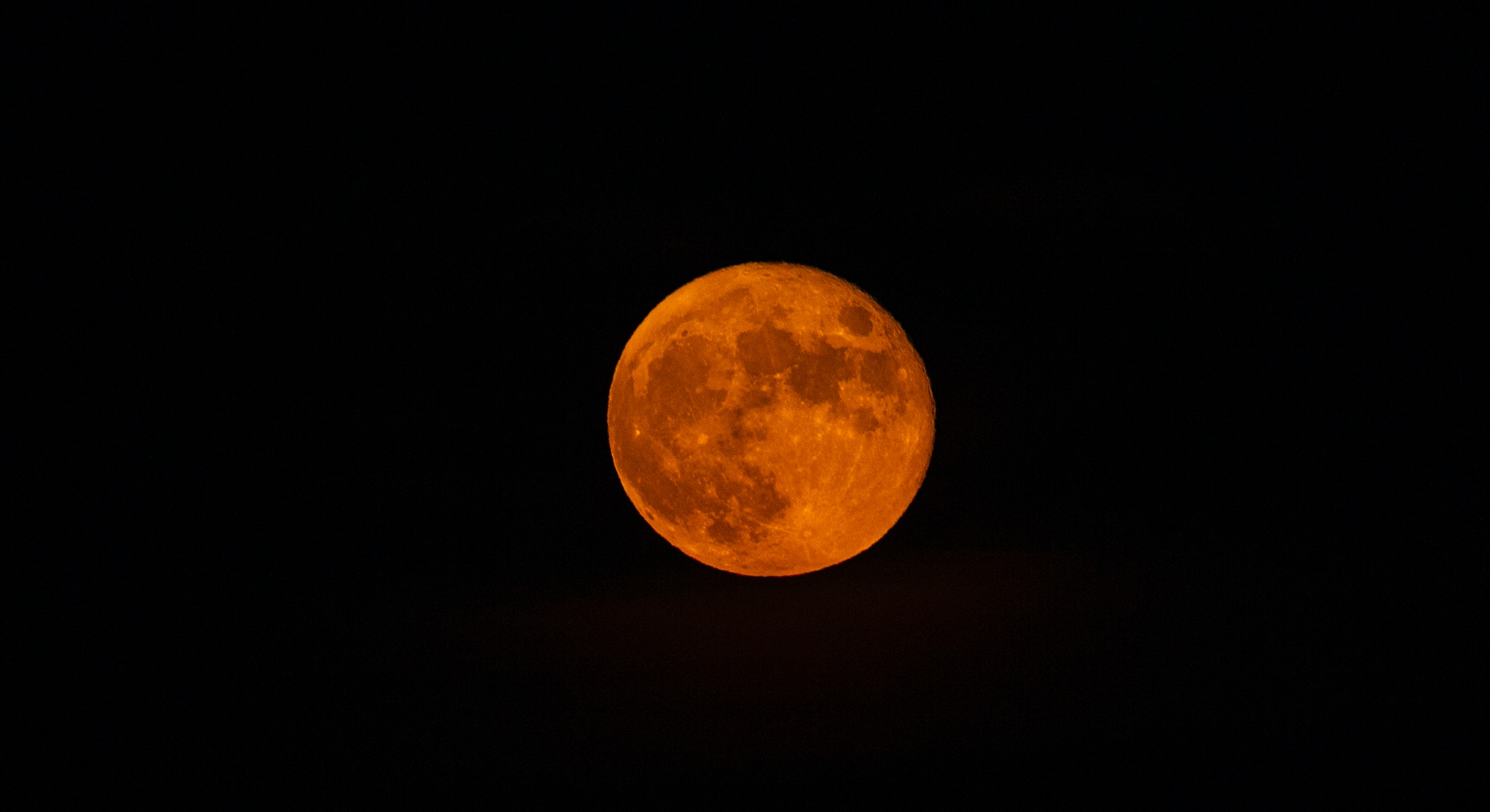 The July 2021 full moon on July 23 is the first full moon of the summer.
