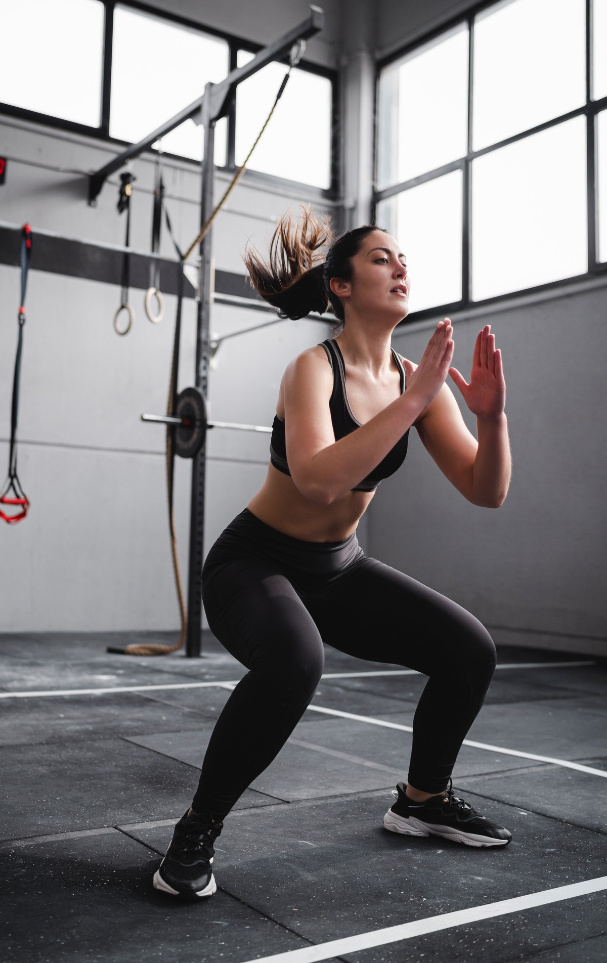 Get low in a classic squat, aka the most fundamental glute exercise.