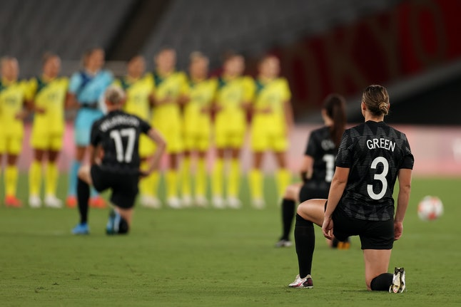 CHOFU, JAPAN - JULY 21: Anna Green #3 of Team New Zealand takes a knee in support of the Black Lives...