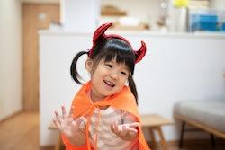 Asian child wearing Halloween costume