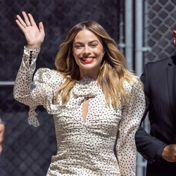 Margot Robbie wears Magda Butrym polka dot silk crepe mini dress for her Jimmy Kimmel Live appearance on July 21, 2021 in Los Angeles, California.
