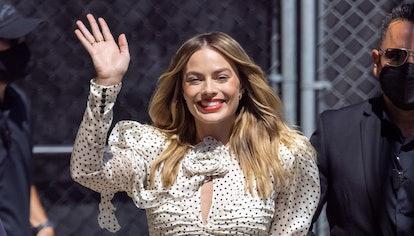 Margot Robbie wears Magda Butrym polka dot silk crepe mini dress for her Jimmy Kimmel Live appearanc...