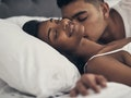 A woman having sex with her partner and feeling good.