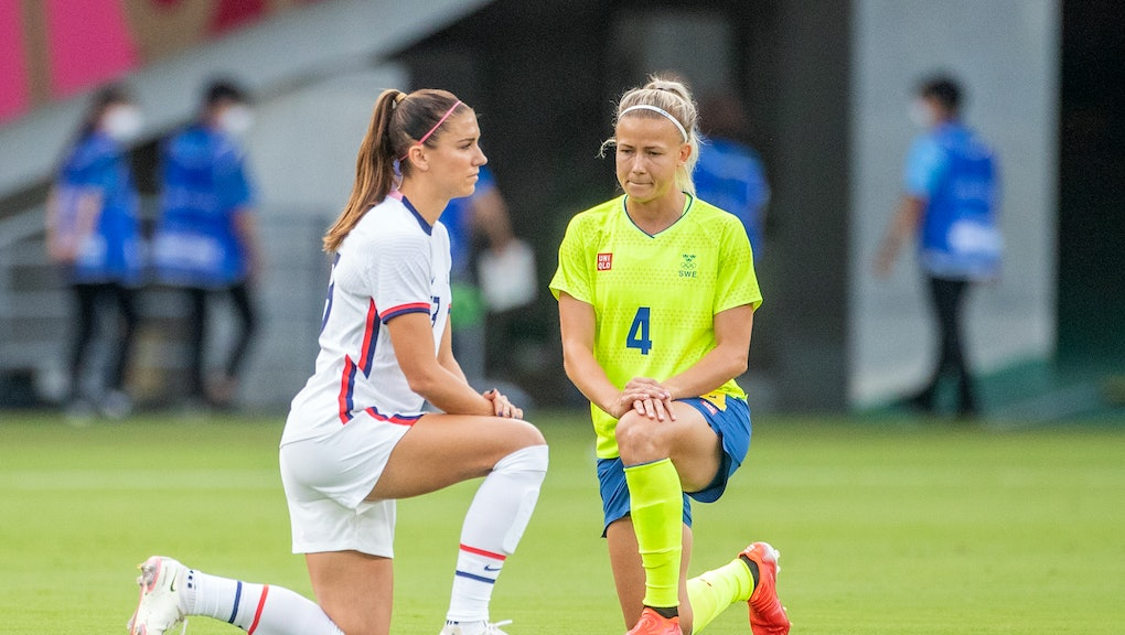 TOKYO, JAPAN - JULY 21:  Alex Morgan. #13 of the United States and Hanna Glas #4 of Sweden take a kn...