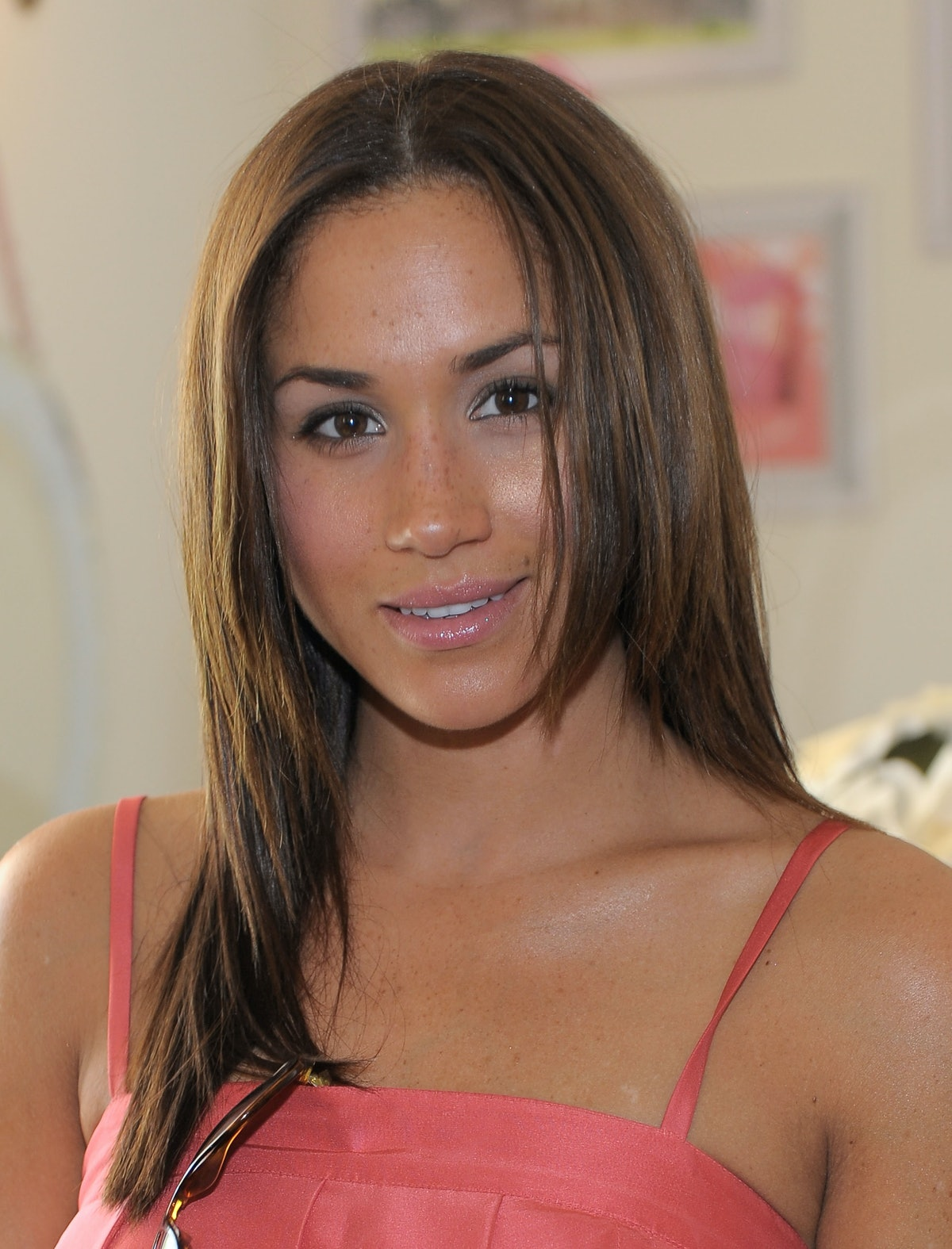 Markle, shown here up-close with a small smile and light brown hair, was still earning small roles i...