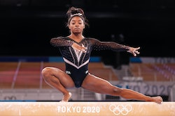 TOKYO, JAPAN - JULY 22: Simone Biles of Team United States trains on balance beam during Women's Podium Training ahead of the Tokyo 2020 Olympic Games at Ariake Gymnastics Centre on July 22, 2021 in Tokyo, Japan. (Photo by Jamie Squire/Getty Images)