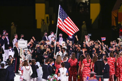 TOKYO, JAPAN - JULY 23: Flag bearers Sue Bird and Eddy Alvares of Team United States lead their team...