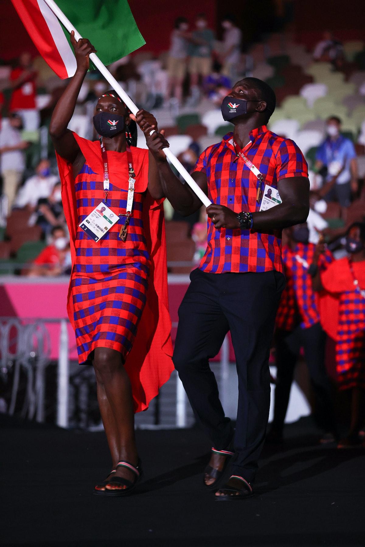 TOKYO, JAPAN - JULY 23: Flag bearers Mercy Moim and Andrew Amonde of Team Kenya lead their team duri...