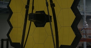 GREENBELT, MD - NOVEMBER 02:  A technician stands next to the James Webb Space Telescope during assembly November 2, 2016 at NASA's Goddard Space Flight Center in Greenbelt, Maryland. The telescope, designed to be a large space-based observatory optimized for infrared wavelengths, will be the successor to the Hubble Space Telescope and the Spitzer Space Telescope. It is scheduled to be launched in October 2018.  (Photo by Alex Wong/Getty Images)