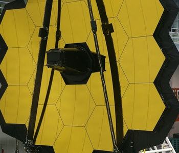 GREENBELT, MD - NOVEMBER 02:  A technician stands next to the James Webb Space Telescope during asse...