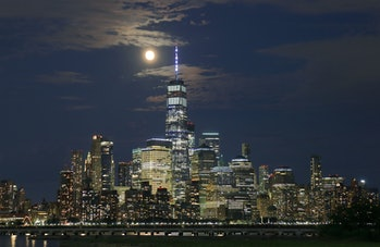 JERSEY CITY, NJ - JULY 22: The Buck Moon rises behind lower Manhattan and One World Trade center a d...