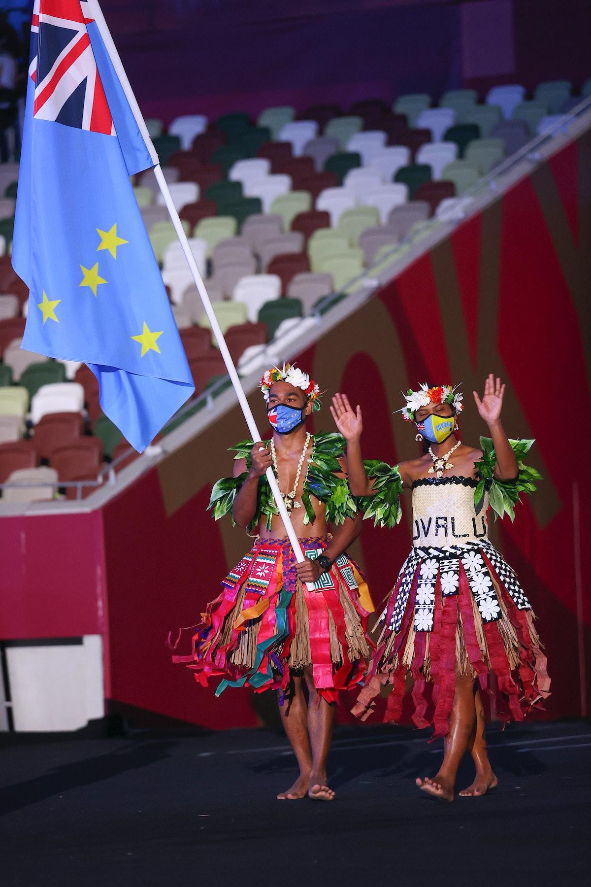 TOKYO, JAPAN - JULY 23: Flag bearers Matie Stanley and Karalo Hepoiteloto Maibuca of Team Tuvalu dur...