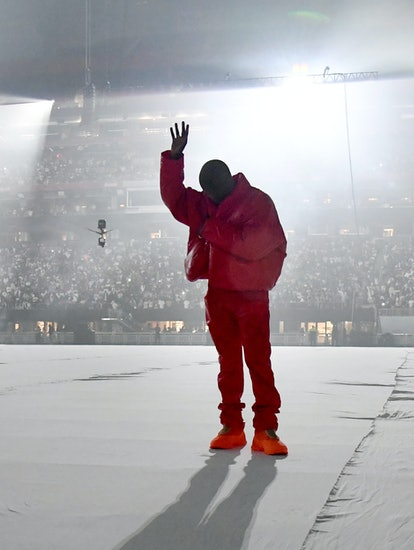 Kanye West, shown here at the 'Donda' listening party in a red outfit, faked out his fans again.