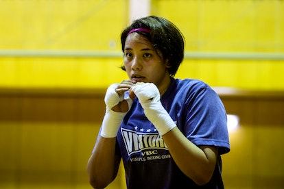 The 2021 Olympics treadmill runner was boxer Arisa Tsubata.