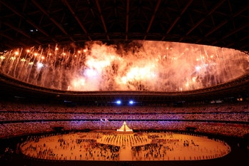 TOKYO, JAPAN - JULY 23: General view inside the stadium as fireworks go off as the Olympic cauldron ...