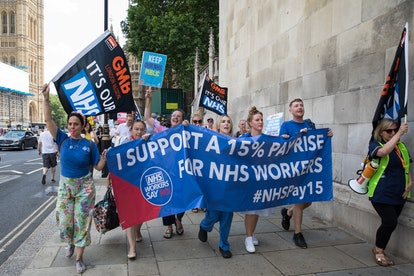NHS workers from the grassroots NHSPay15 campaign march from Parliament to 10 Downing Street to present Matthew Tovey's petition signed by over 800,000 people calling for a 15% pay rise for NHS workers on 20th July 2021 in London, United Kingdom. At the time of presentation of the petition, the government was believed to be preparing to offer NHS workers a 3% pay rise in 'recognition of the unique impact of the pandemic on the NHS'. (photo by Mark Kerrison/In Pictures via Getty Images)