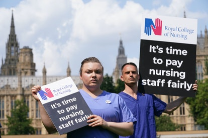 Nurses with placards outside the Royal College of Nursing (RCN) in Victoria Tower Gardens, London, following the Government's announcement of the NHS pay offer. Picture date: Wednesday July 21, 2021. (Photo by Jonathan Brady/PA Images via Getty Images)