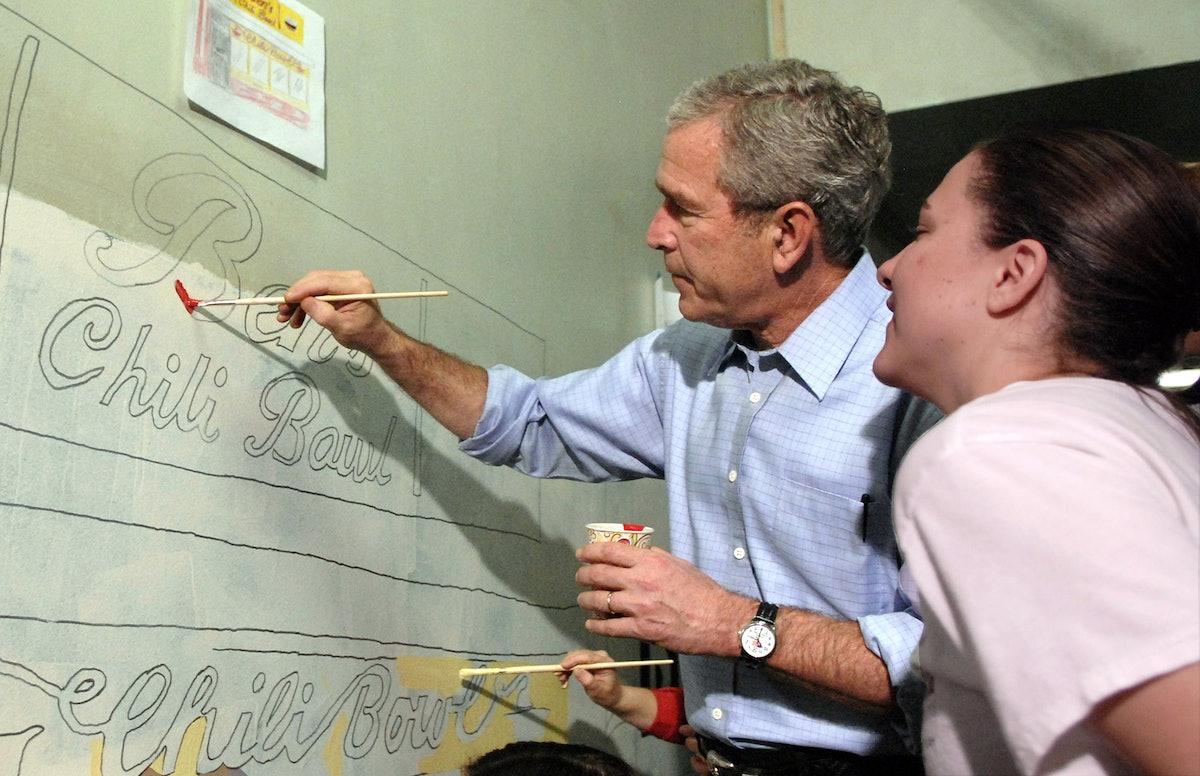 WASHINGTON - JANUARY 15:  (AFP OUT) U.S. President George W. Bush helps paint a mural along side Cit...