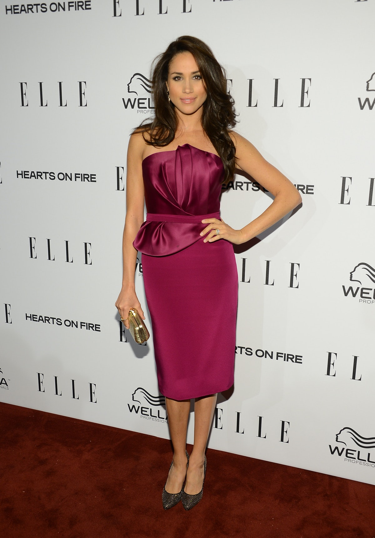 Markle, shown here in a fuschia pencil dress at an Elle event, was serving looks.