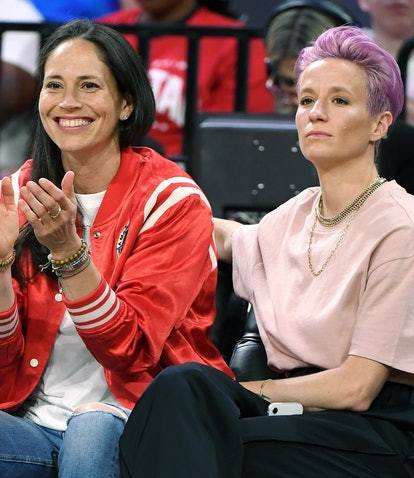 LAS VEGAS, NEVADA - JULY 27:  Sue Bird (L) of the Seattle Storm and soccer player Megan Rapinoe atte...