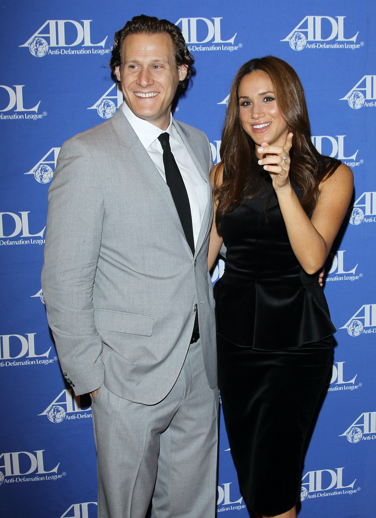 Markle, shown here in a black dress with her ex-husband, Trevor Engelson, landed a role in 'Suits' i...