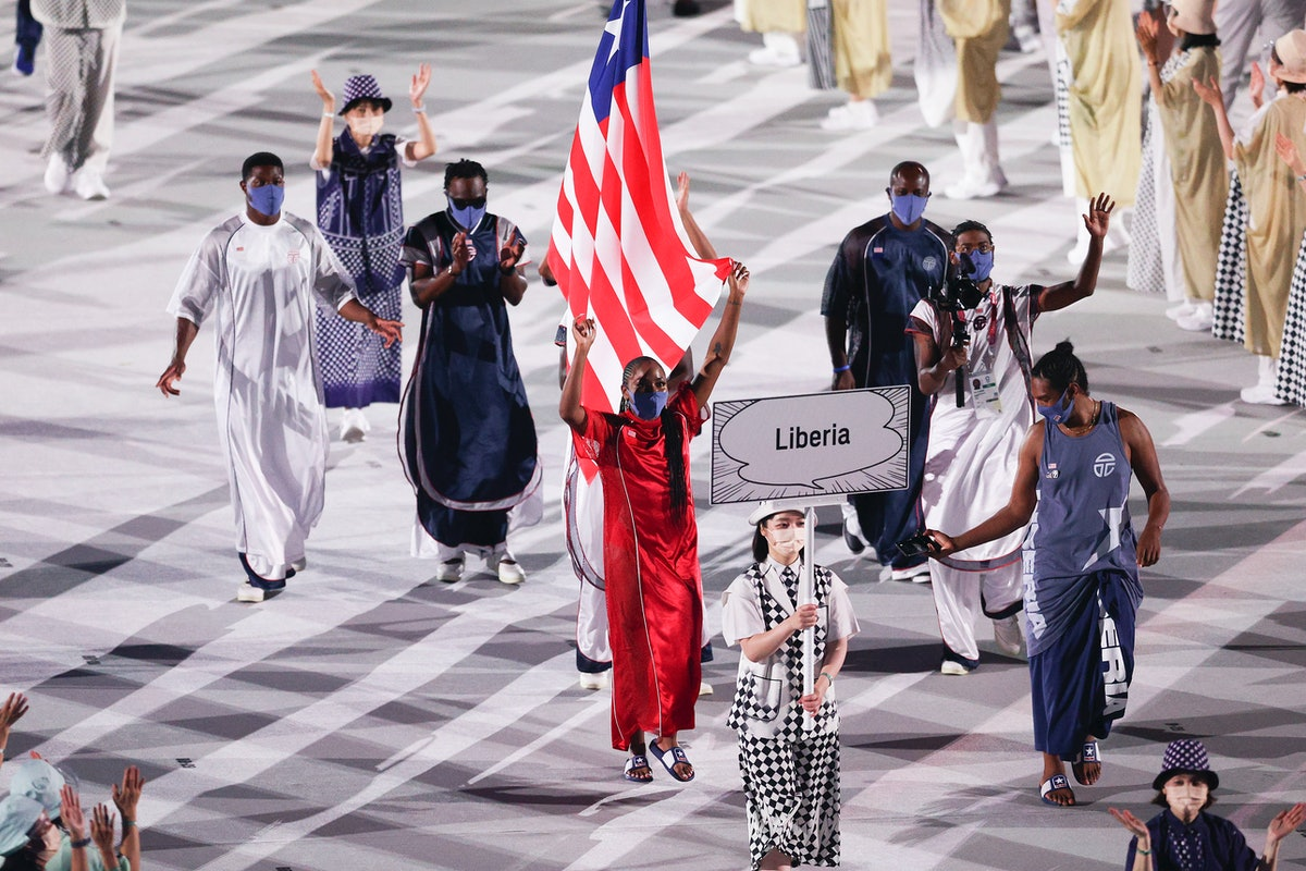 Flag bearers Ebony Morrison and Joseph Fahnbulleh of Team Liberia wear uniforms designed by Telfar C...