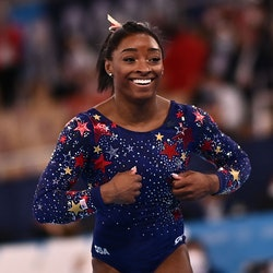 USA's Simone Biles reacts after competing in the artistic gymnastics balance beam event of the women's qualification during the Tokyo 2020 Olympic Games at the Ariake Gymnastics Centre in Tokyo on July 25, 2021. (Photo by Loic VENANCE / AFP) (Photo by LOIC VENANCE/AFP via Getty Images)