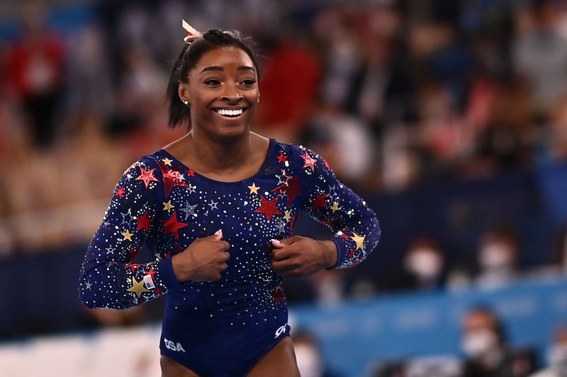USA's Simone Biles reacts after competing in the artistic gymnastics balance beam event of the women...