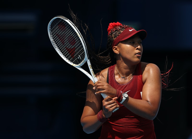 TOKYO, JAPAN - JULY 25: Naomi Osaka of Team Japan plays a backhand during her Women's Singles First ...