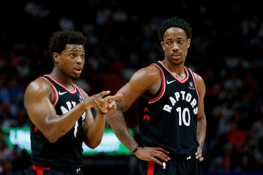 MIAMI, FL - APRIL 11:  DeMar DeRozan #10 and Kyle Lowry #7 of the Toronto Raptors look on against th...