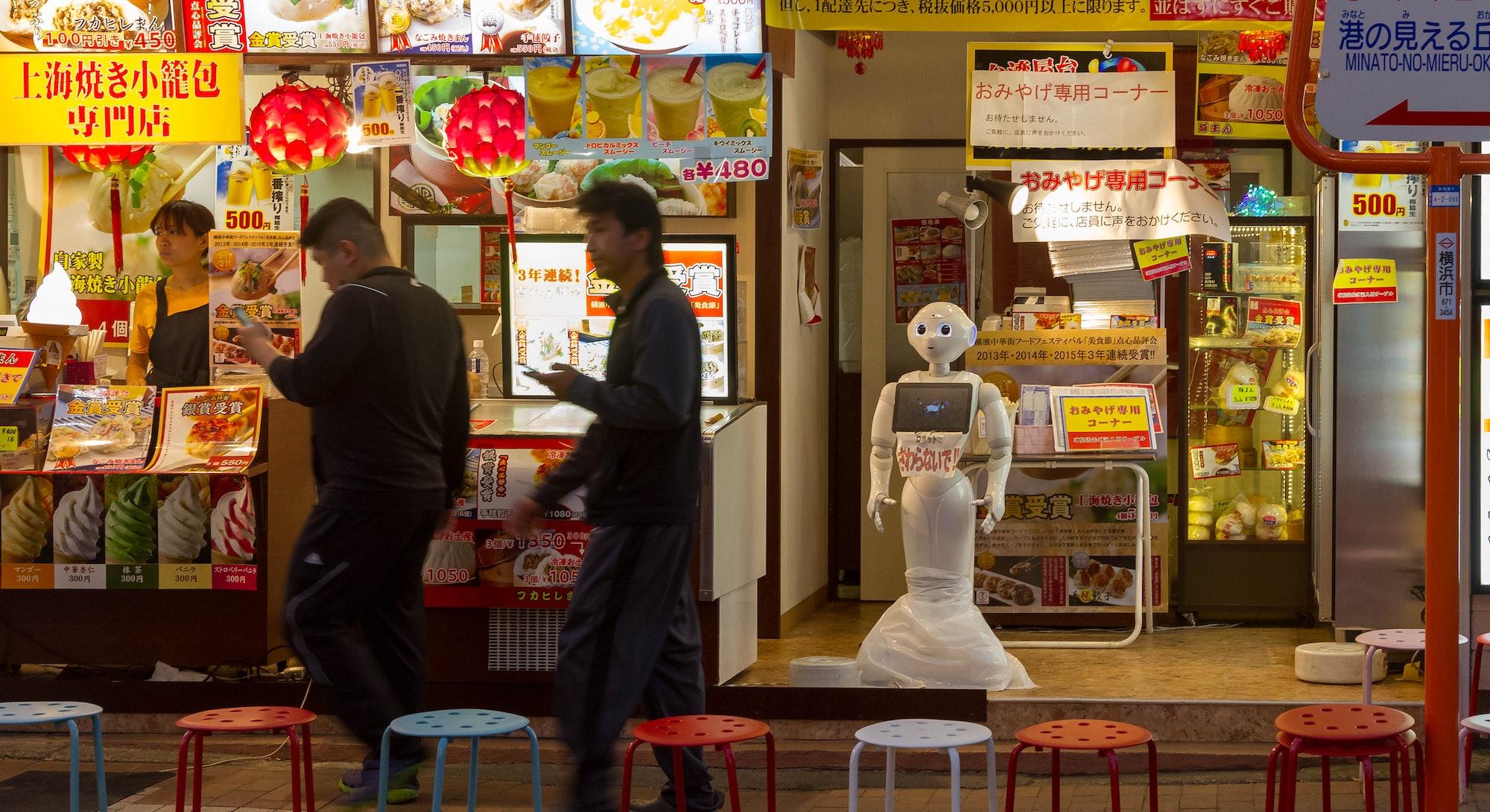 OMOTESANDO, JAPAN - 2016/07/29: A humanoid Pepper robot welcomes people to a restaurant in Yokohama ...