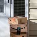 Amazon delivery, packages at residential door, Vadnais Heights, Minnesota. (Photo by: Michael Siluk/Education Images/Universal Images Group via Getty Images)