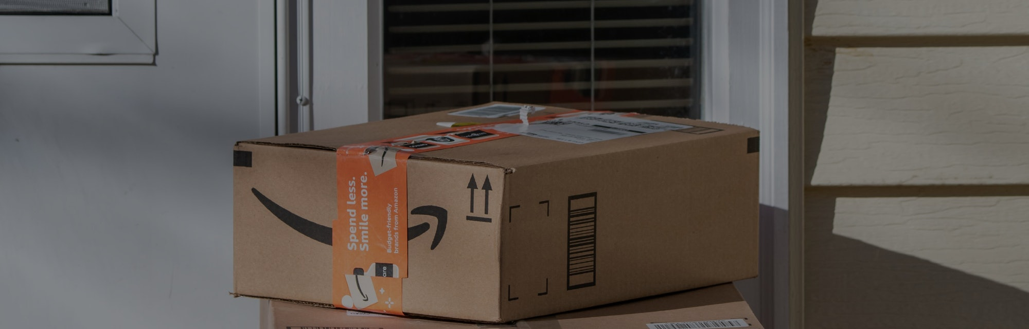 Amazon delivery, packages at residential door, Vadnais Heights, Minnesota. (Photo by: Michael Siluk/...