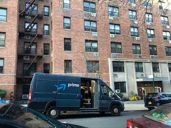 Amazon Prime delivery van parked outside apartment building, Forest Hills, Queens, NY. (Photo by: Li...