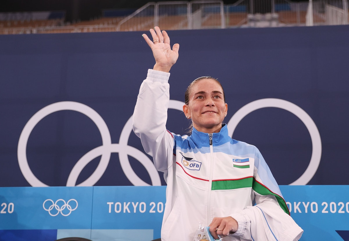 Oksana Chusovitina of Uzbekistan reacts after the women's artistic gymnastics qualification at the T...