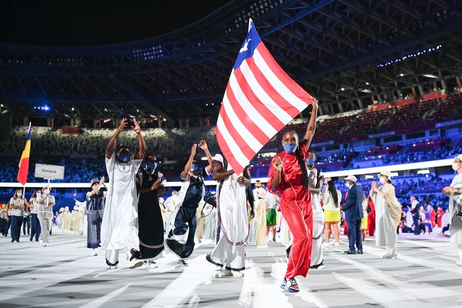 TOKYO, JAPAN - JULY 23: Flag bearers Ebony Morrison and Joseph Fahnbulleh of Team Liberia walk their team out during the Opening Ceremony of the Tokyo 2020 Olympic Games at Olympic Stadium on July 23, 2021 in Tokyo, Japan. (Photo by Matthias Hangst/Getty Images)