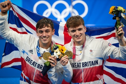 TOKYO, JAPAN - JULY 26: (BILD ZEITUNG OUT) Matty Lee and Thomas Daley of Great Britain celebrate wit...
