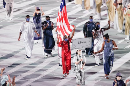 TOKYO, JAPAN - JULY 23: Flag bearers Ebony Morrison and Joseph Fahnbulleh of Team Liberia during the Opening Ceremony of the Tokyo 2020 Olympic Games at Olympic Stadium on July 23, 2021 in Tokyo, Japan. (Photo by Patrick Smith/Getty Images)