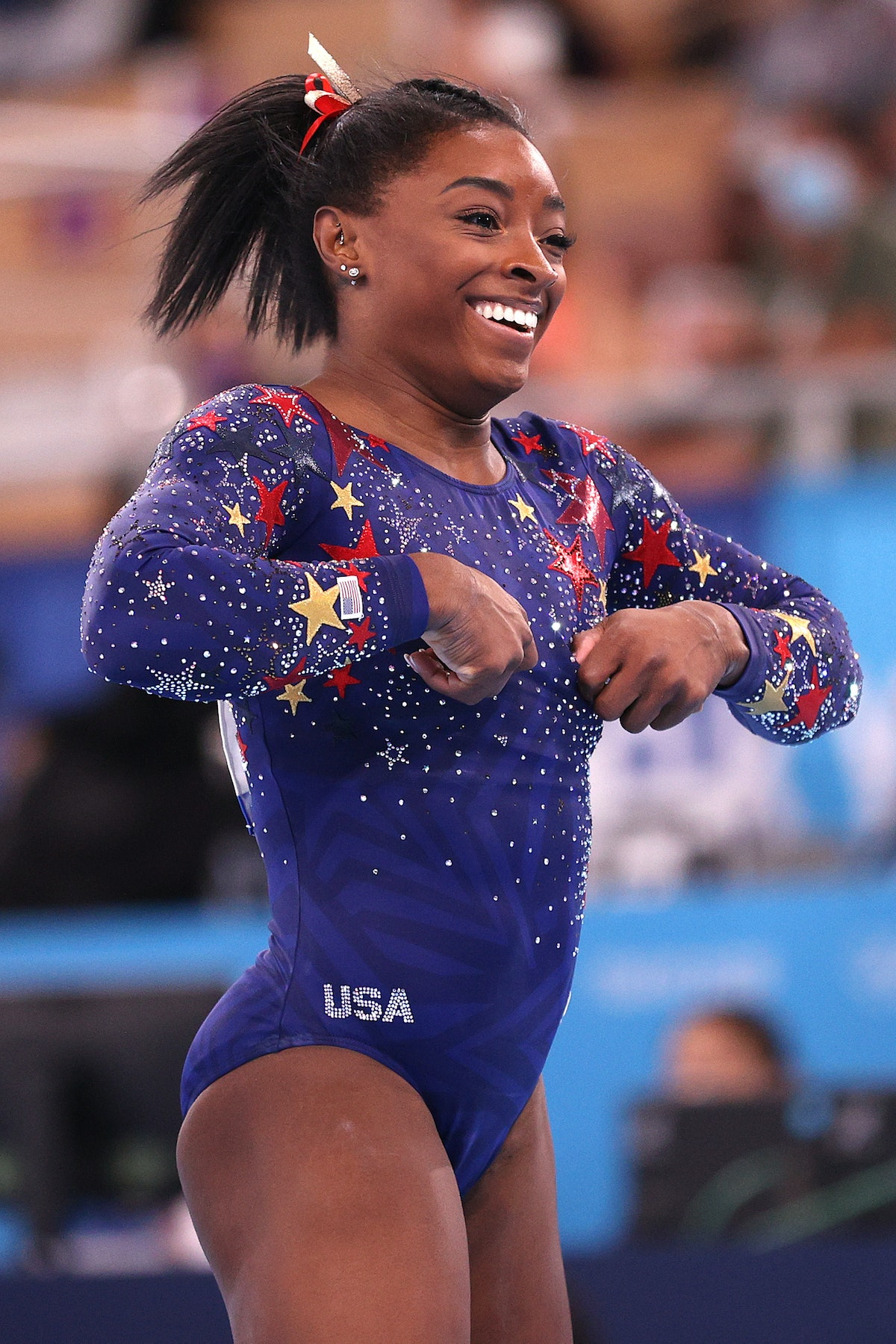 TOKYO, JAPAN - JULY 25: Simone Biles of Team United States reacts after competing on balance beam during Women's Qualification on day two of the Tokyo 2020 Olympic Games at Ariake Gymnastics Centre on July 25, 2021 in Tokyo, Japan. (Photo by Ezra Shaw/Getty Images)