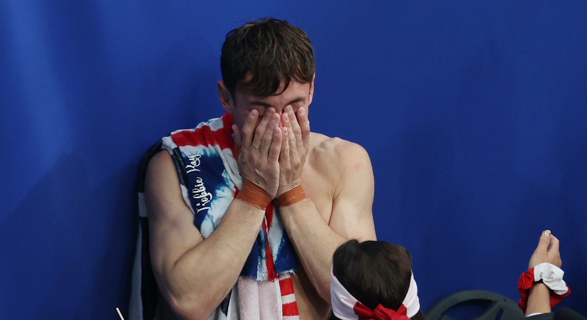 Tom Daley of Team Great Britain celebrates after winning gold.