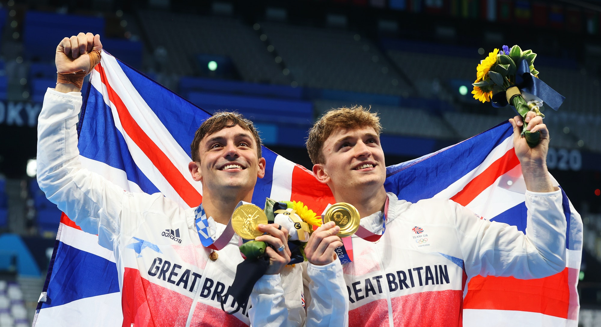 Tom Daley and Matty Lee of Team Great Britain pose for photographers with their gold medals after wi...