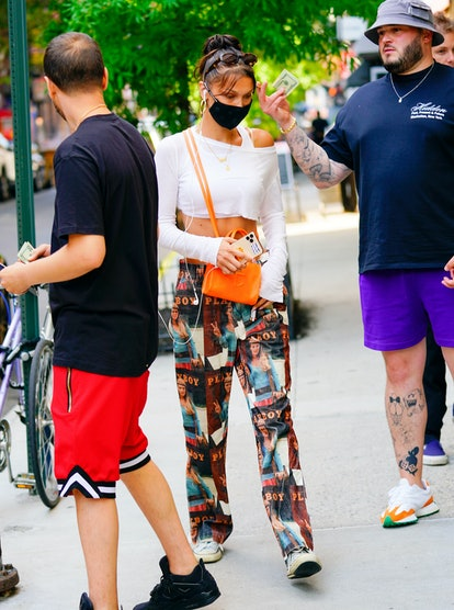 NEW YORK, NEW YORK - JULY 02: Bella Hadid is seen wearing a protective face mask during the COVID-19...